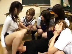 Schoolgirls in detention playful and play with thumbs and t
