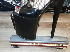 Female L punch instruct with sexy ebony 20 cm extreme high heels.