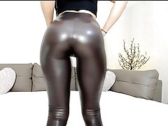Steaming cam teen in shiny leggings with good ass tease