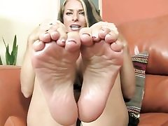 Appetizing looking babe is unsheathing her feet and is prepared to give footjob