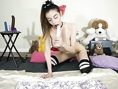 Cute nymph is playing with her beaver plumbing her anal hole in her room