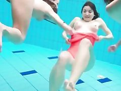 3 frolic stunners swimming in the pool and taking off their bikini