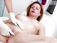 Horny red haired babe gets her cunt slot investigated on a gyno chair