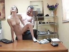 Bony tramp gets slammed on the office table and sucks man rod