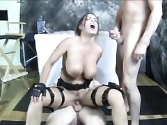 Kinky Lara Croft with immense boobs gets fucked by two wild boys