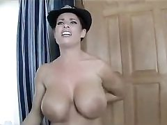 Steaming police lady stripping naked revealing her impressive tits on cam